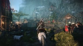 The Witcher 3 riding through the village